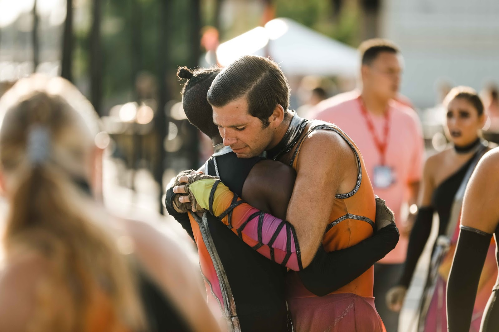 Members of the Crossmen hug as they say goodbye after their 2017 Finals performance