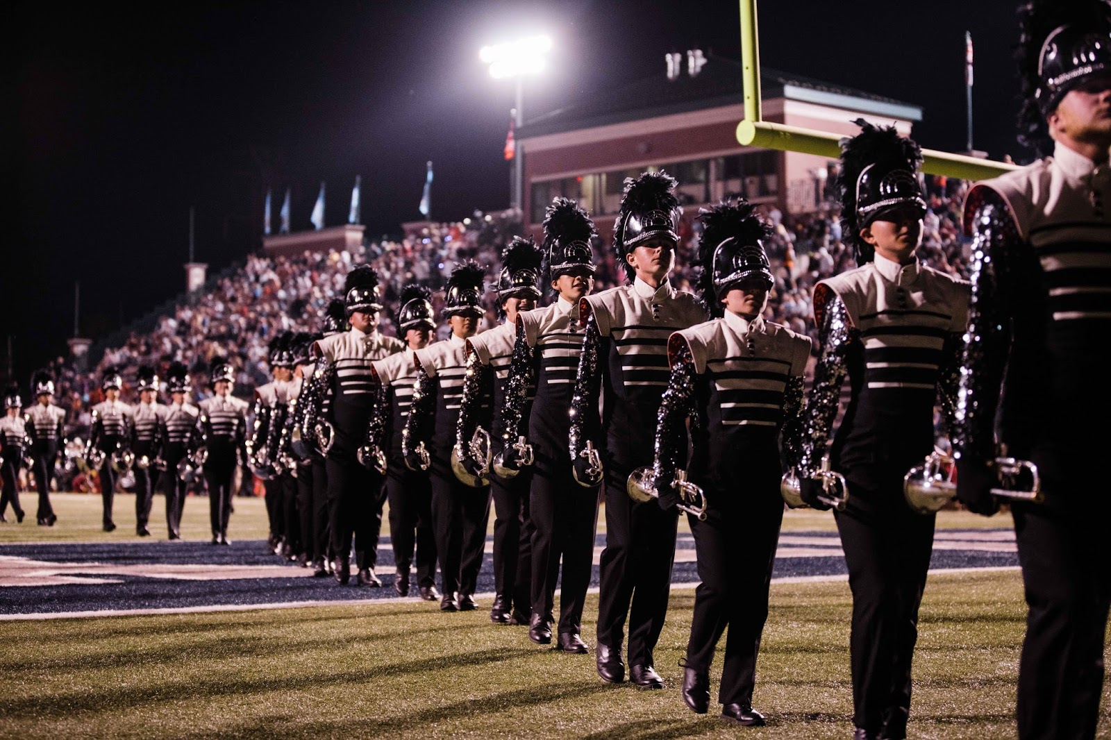 Phantom Regiment corps walks off the field at a DCI performance